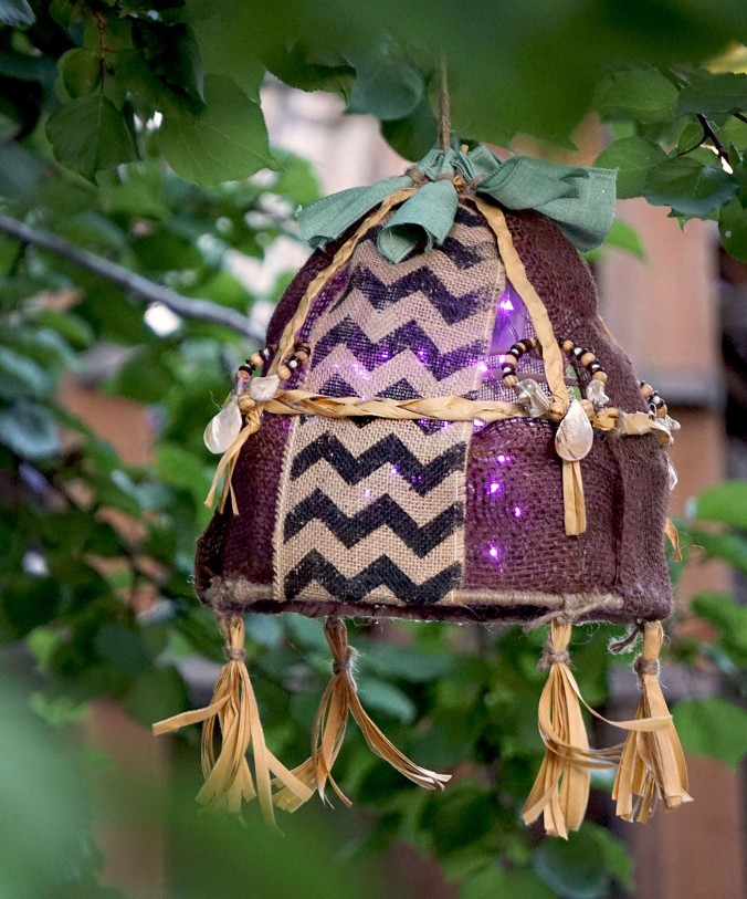 hanging light made of burlap with dangling tassels